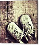 Baby Shoes On Wood Canvas Print