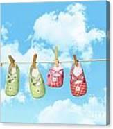 Baby Shoesr And Teddy Bear On Clothline Canvas Print