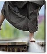 Balance On Railroad Tracks Canvas Print