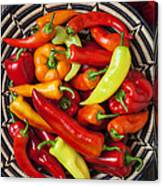 Basketful Of Peppers Canvas Print