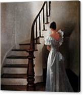 Beautiful Young Woman Standing In Gown By Stairs Canvas Print