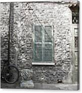 Bicycle Leaning Against A Stone House Canvas Print