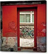 Bicycles In Red Doorway Canvas Print