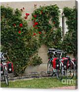 Bicycles Parked By The Wall Canvas Print