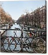 Bikes On The Canal In Amsterdam Canvas Print