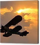 Biplane At Sunset Canvas Print