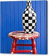 Blach And White Vase On Stool Against Blue Wall Canvas Print