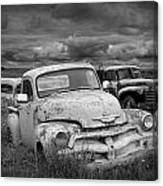 Black And White Photograph Of A Junk Yard With Vintage Auto Bodies Canvas Print
