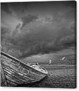 Boat Stranded On A Beach Covered By Menacing Storm Clouds Canvas Print