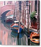 Boats Bridge And Reflections In A Venice Canal Canvas Print