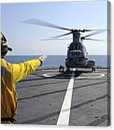 Boatswain's Mate Directs A Ch-46 Sea Canvas Print