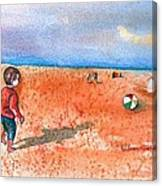 Boy At Beach Playing And Chasing Ball Canvas Print