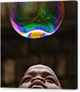 Boy Blowing Bubble Canvas Print
