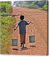 Boy Carrying Drinking Water Canvas Print