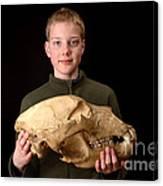 Boy Holding Kodiak Bear Skull Canvas Print