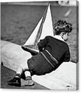 Boy Playing With Toy Sailboat Canvas Print