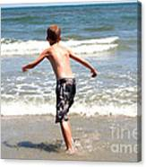 Boy Running Into Surf Canvas Print