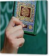 Boy's Hand Holding Koran Canvas Print