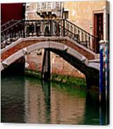 Bridge And Striped Poles Over A Canal In Venice Canvas Print