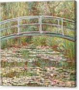 Bridge Over A Pond Of Water Lilies Canvas Print