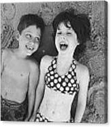 Brother And Sister On Beach Canvas Print