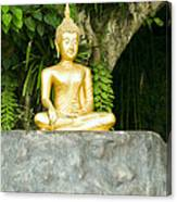 Buddha Statue Under Green Tree In Meditative Posture Canvas Print