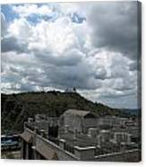 Buildings Cover The Lower Section Of A Hill That Has A Temple At The Top With Clouds Covering The Sk Canvas Print