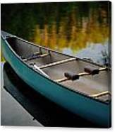 Canoe And Reflections On A Still Lake Canvas Print