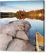 Canoe At A Rocky Shore Autumn Nature Scenery Canvas Print