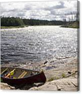 Canoe Pulled Up On The Shore Canvas Print