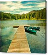 Canoes At The End Of The Dock Canvas Print