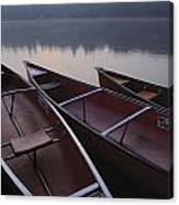 Canoes On Still Water Canvas Print