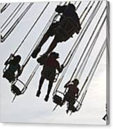 Carnival Goers Enjoy A Ride At An Canvas Print