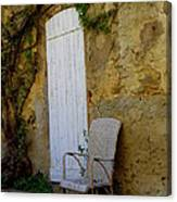 Chair By The White Door Canvas Print