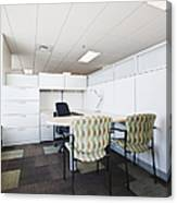 Chairs And Desk In Office Cubicle Canvas Print