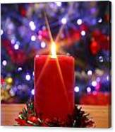 Christmas Candle With Starburst And Decorated Tree Background. Canvas Print