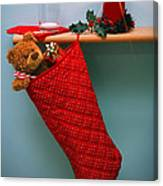 Christmas Stocking Filled With Presents With Empty Milk Glass.  Canvas Print