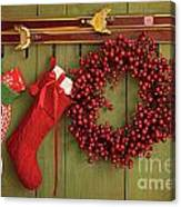 Christmas Stockings And Wreath Hanging On  Wall Canvas Print