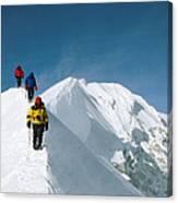 Climbers Hike Along A Ridge Canvas Print