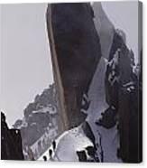 Climbers Move Carefully Across Steep Canvas Print