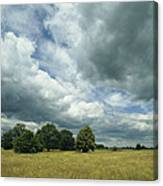 Cloud-filled Sky Over A Cluster Canvas Print
