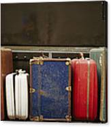Colorful But Worn Luggage Awaits Canvas Print
