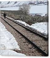 Conductor Walking On Empty Railroad Tracks Canvas Print