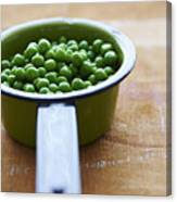 Cooking Pot With Green Peas Canvas Print