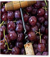 Corkscrew And Wine Cork On Red Grapes Canvas Print