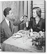 Couple Toasting At Dinner Table, (b&w), Elevated View Canvas Print