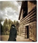 Cowboy Walking By Barn Canvas Print