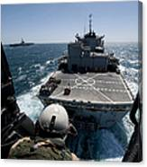 Crewman Guides The Pilots Of An Hh-60h Canvas Print