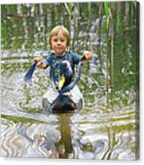 Cute Tiny Boy Riding A Duck Canvas Print