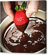 Dipping Strawberry In Chocolate Canvas Print